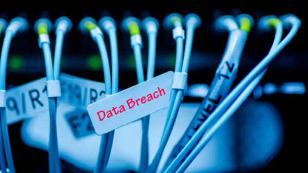 Photo of computer cables with label Data Breach in red